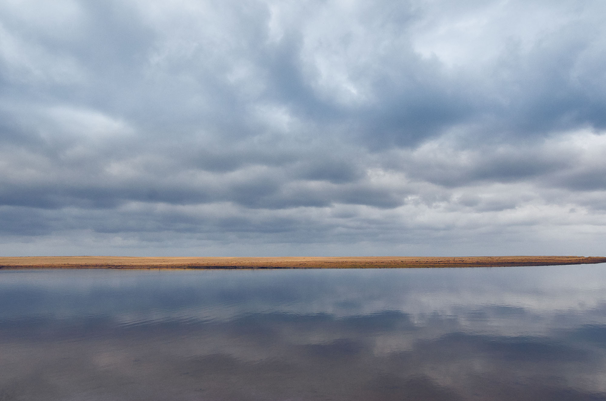 clouds-river-bank-reflection